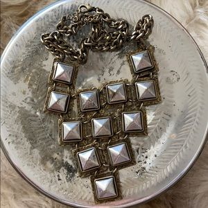 Silver studded necklace.